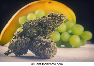 Dried cannabis buds (Grape Ape strain) with fresh fruit -...