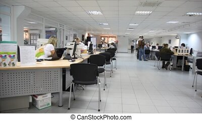 Panorama office of car salon, where its employees advise...
