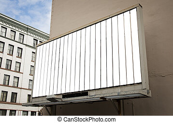 Rotating Billboard - A blank white rotating billboard in an...