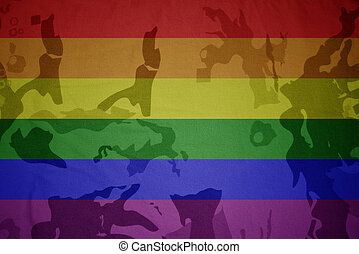 gay pride rainbow flag on the khaki texture . military concept