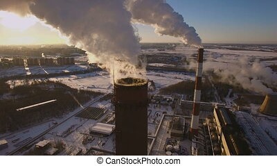 Smoking chimneys power station on sunset background in the...