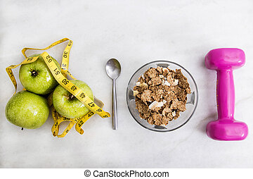 top view of the cereal with fruit, measuring tape and...