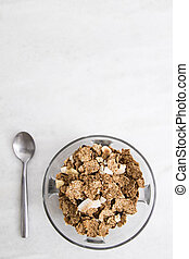 bowl of cereal integral with the spoon on background white