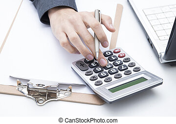 hands with the calculator on the desk, finance and business...