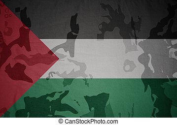 flag of palestine on the khaki texture . military concept -...