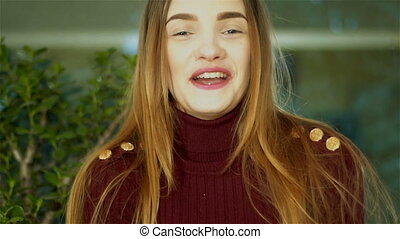 cutie young lady with nice make up looking at the camera and...