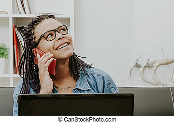 woman with the phone mobile and the computer in house