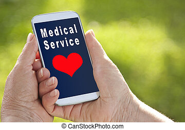 hand of senior health service with mobile phone