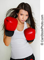 studio shot of beautiful female boxer