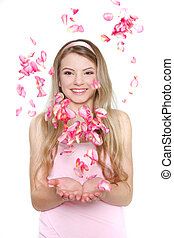 young happy woman in rose petals