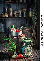 Vintage wooden cellar with fresh herbs and vegetables