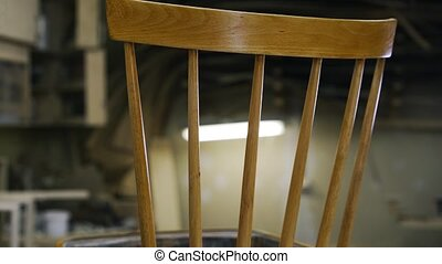 A carpenter is restoring the wooden chair. close up. - A...