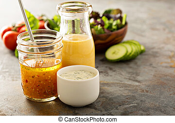 Variety of sauces and salad dressings - Variety of homemade...