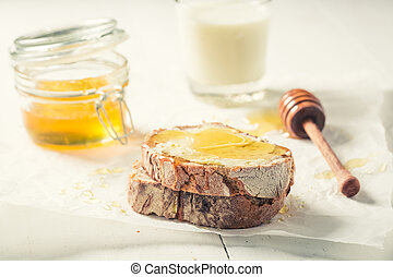 Sweet sandwich with honey and wholegrain bread