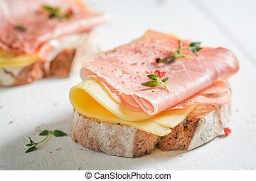 Crisp a piece of bread with cheese and ham