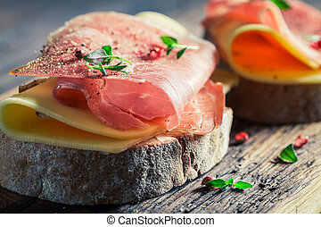 Tasty a piece of bread with cheese and ham