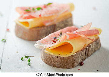 Fresh a piece of bread with cheese and ham