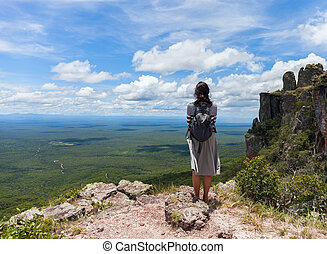 boundless expanse. view from mountains. Person girl standing...