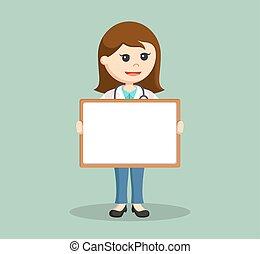female doctor holding whiteboard
