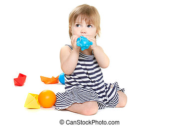 cute toddler girl playing over white