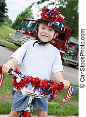 Young boy on a bicycle on the 4th of July - Young boy on a...