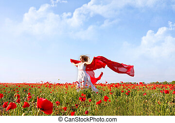 beautiful woman running in poppy field with red scarf