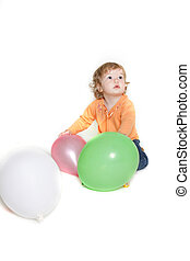 cute toddler girl with balloons over white
