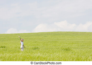 young happy girl in green field