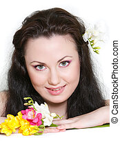 beautiful woman with flowers over white