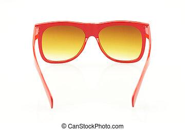 Red eyeglasses on white background