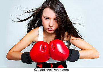 portrait of beautiful aggressive female boxer