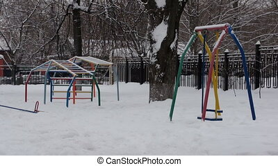 Playground in winter with no one walking - Winter playground...