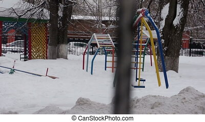 Playground in winter day with no one walking - Playground in...