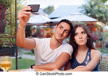 Romantic Couple on a Date at the Restaurant Taking a Selfie...