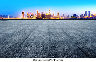 Modern city skyline - empty marble floor with cityscape and...