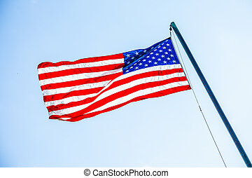 American flag on flagpole - Front view of American flag on...