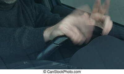 Nervous driver tapping and gesturing - Nervous driver,...