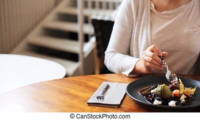 woman eating ice cream dessert with coffee at cafe - food,...
