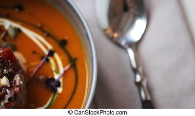 close up of vegetable pumpkin-ginger soup in bowl - food,...