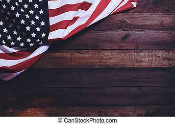 US flag - star striped flag of the USA on rough dark wooden...