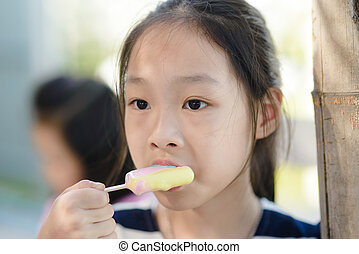 Portrait of Asian girl eating an ice-cream