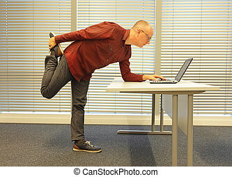 middle age caucasian male leg exercise during office work -...