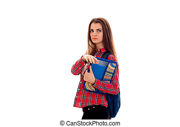 portrait of young serious student girl with backpack and folders for notebooks isolated on white background