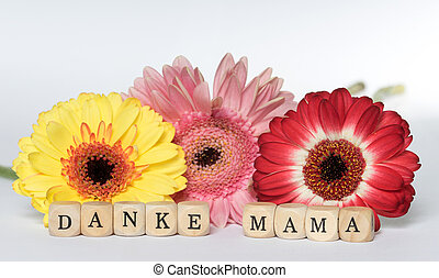 Mothers Day - Wooden Cubes with the german words Mothers Day...