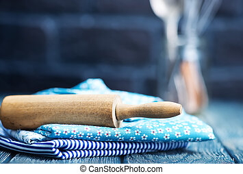 kitchenware on the wooden table, napkin and kitchenware