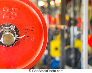 Barbell ready to workout in gym. Shallow DOF. Copy space....