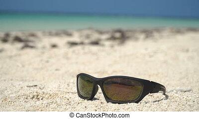 Sunglasses on the beach - Sunglasses on the sandy beach with...