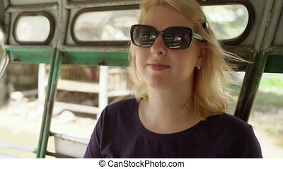 Woman in asian pickup car - Blonde woman in asian pickup car...