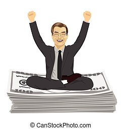 Mature businessman with arms up celebrating his success...