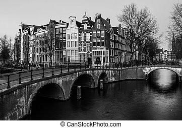 Amsterdam, Netherlands canals and bridges. Night view of...